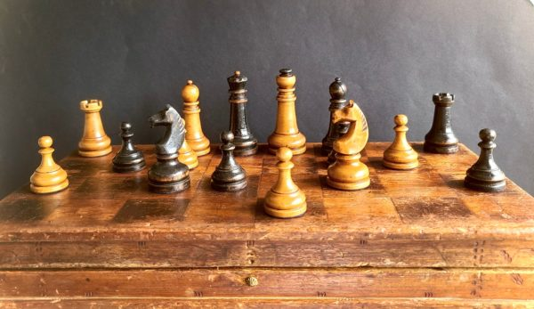 The Imperials Chess Set Black and White Pieces on Board